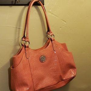 Very cute coral color purse